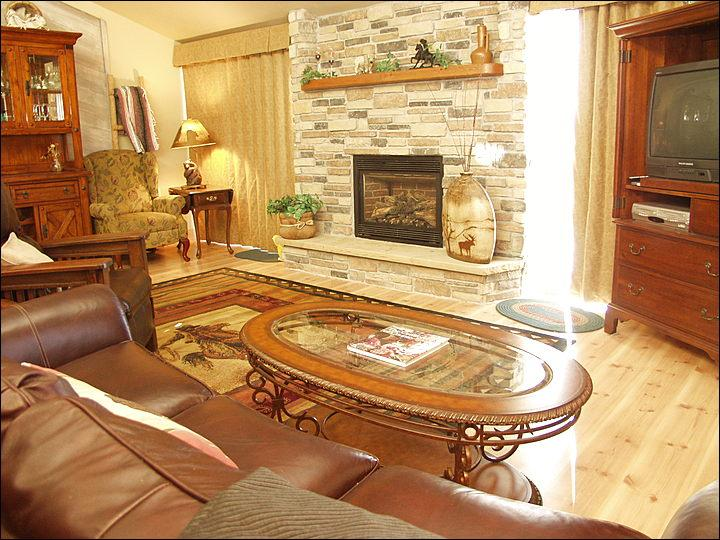 Beautiful Living Room features Leather Furniture, Fireplace, Hardwood Floors, TV, DVD, & Balcony with Gas Grill! - Only 150 Yards to Ski Slopes - Warm, Comfy, & Updated Property (3832) - Steamboat Springs - rentals