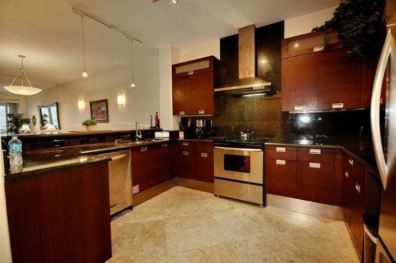 Kitchen with custom cabinetry. - Imagine...133 Mariners Club Key Largo - Key Largo - rentals