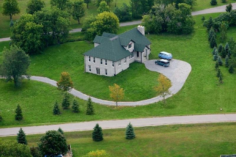 Breath-taking aerial view of the charming English-style stone home. - 4000 sq. ft. English-style stone house - Uxbridge - rentals