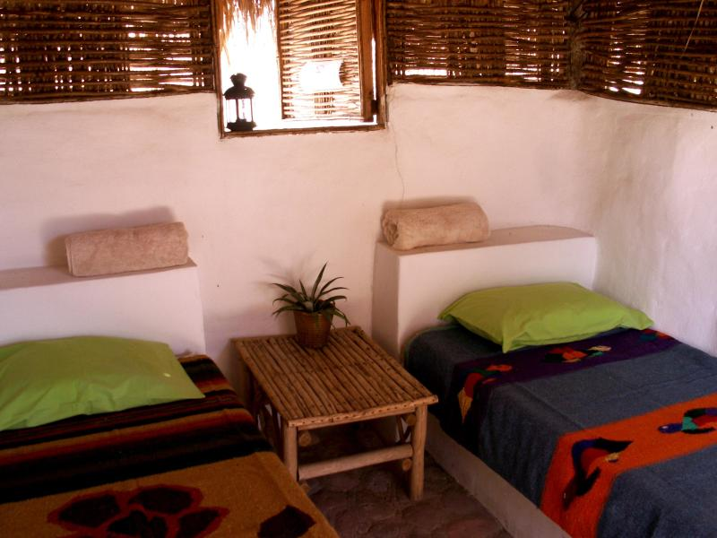 inside our bedrooms two single beds or one queen size - La Duna eco-retreat center - La Paz - rentals