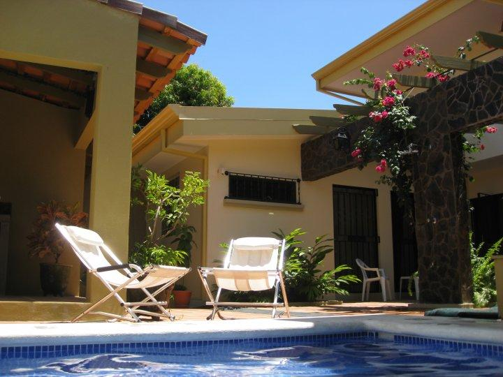 Relaxing by the patio pool - Affordable Luxury Vacation Rental in Costa Rica - Puntarenas - rentals