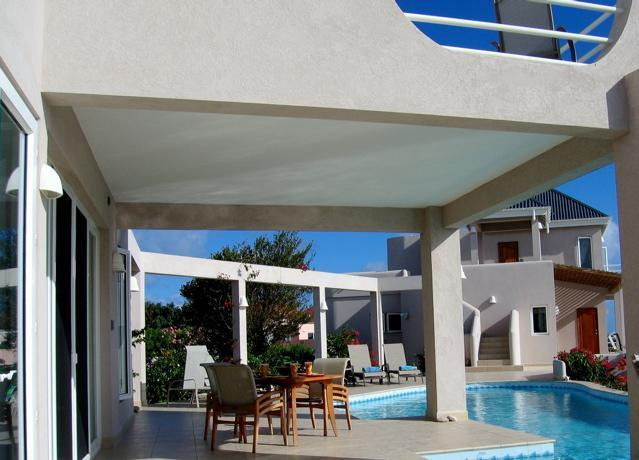 Patio space shaded by balcony of Master Villa, and view of Guest Villa. - VILLA GARDENIA EXCEPTIONAL VALUE: 1or 5 bed RENT - Long Bay Village - rentals