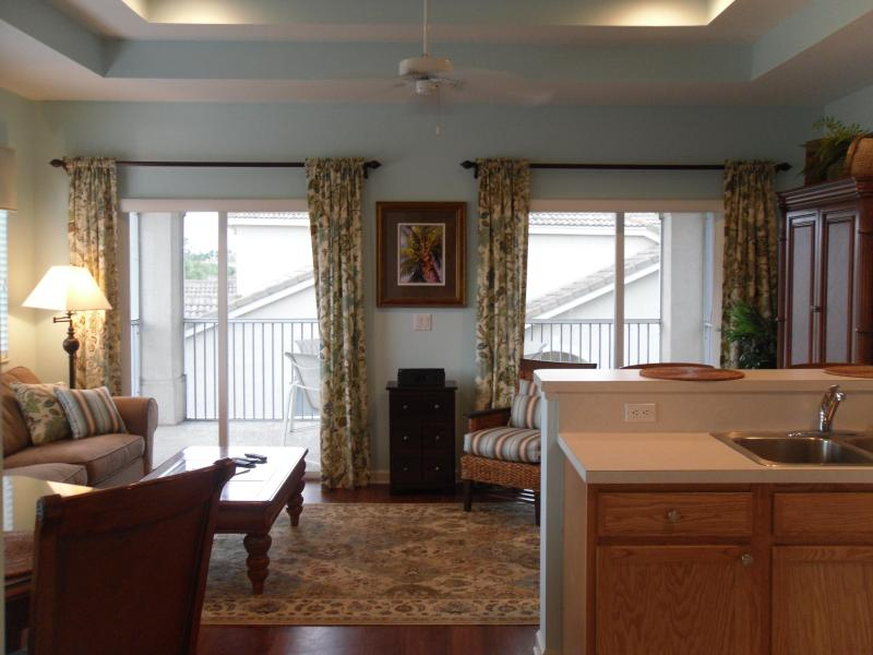 Open Living Room/Kitchen area with high ceilings and double sliding doors open up to screen patio - Updated PGA Village Condo with HDTV & secure WiFi - Port Saint Lucie - rentals