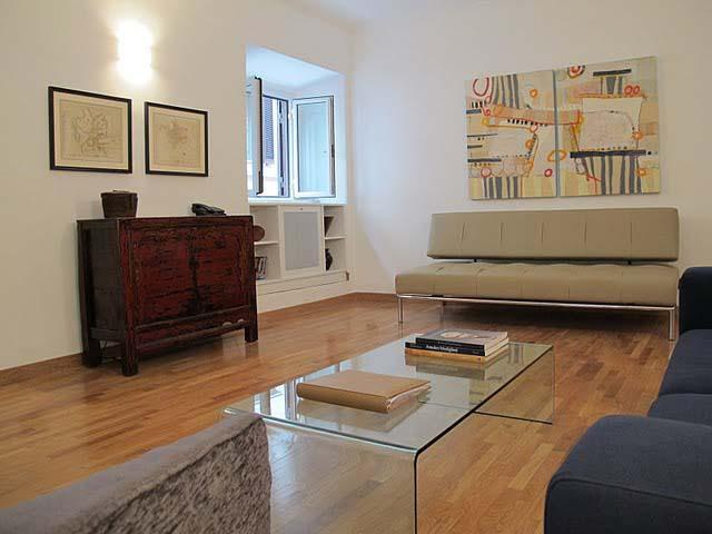 Living room - spacious and light, with modern furniture and beautiful artwork. - The Spanish Steps Apartment on Via della Mercede - Rome - rentals
