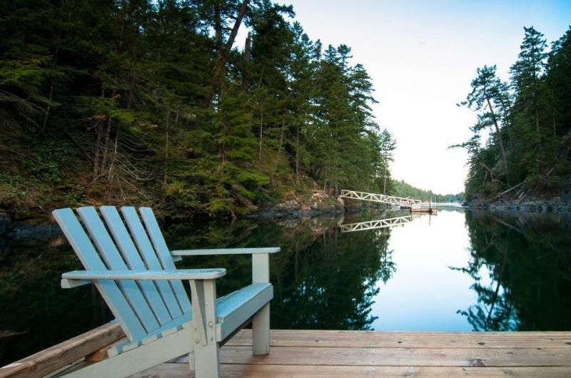 Relax on the dock - Waterfront cottage high in the Tree Tops of Secret Cove - Halfmoon Bay - rentals