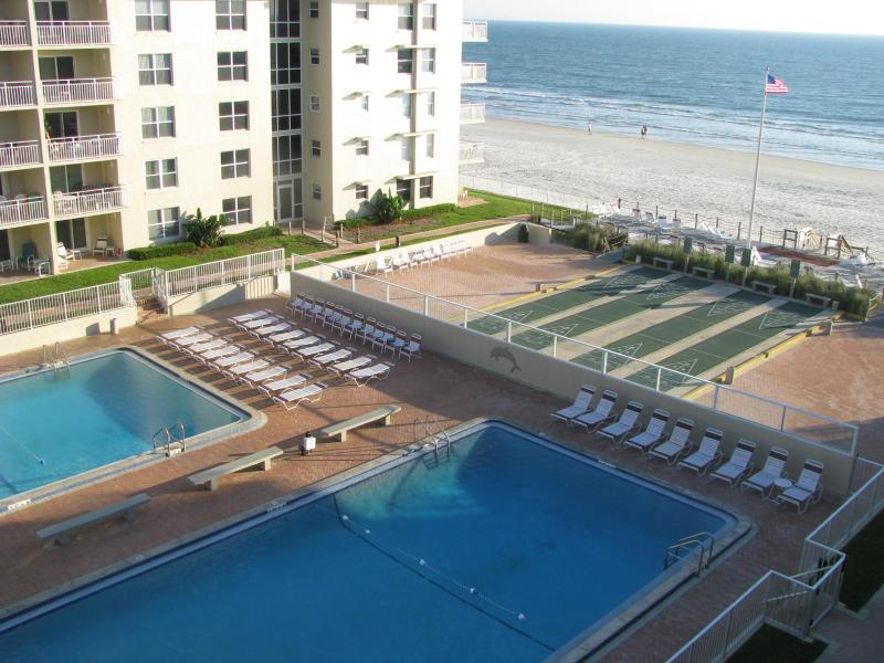 View from our balcony - Sea Coast Gardens Condo with view of Atlantic Ocean - Access to Olympic Size Pools and 4 Lighted Shuffleboard Courts  - 2BR/2BA CONDO;GREAT VIEW AND FALL RATES! - New Smyrna Beach - rentals