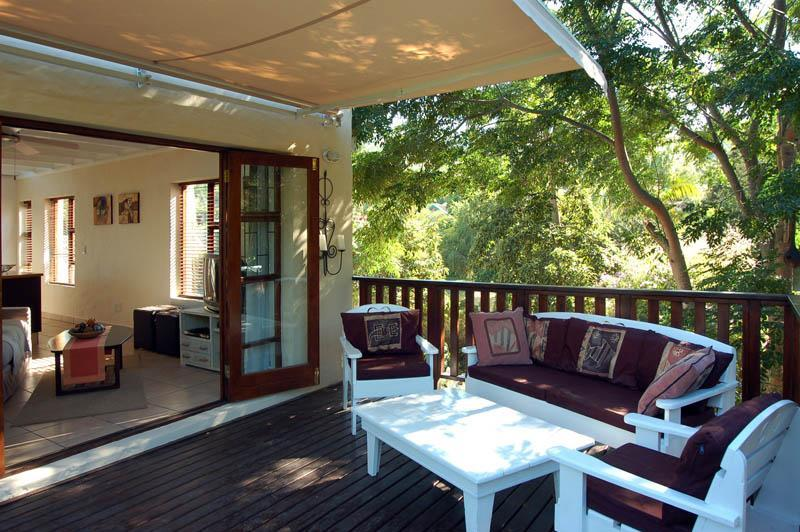 Large decking amongst the Syringa trees and Bamboo - 2 storey  cottage in the heart of the Garden Route - Knysna - rentals