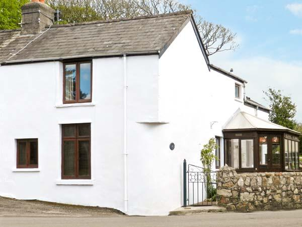 CORNER COTTAGE, semi-detached cottage, next to the village green, with Rayburn and conservatory in Reynoldston, Ref 14219 - Image 1 - Reynoldston - rentals