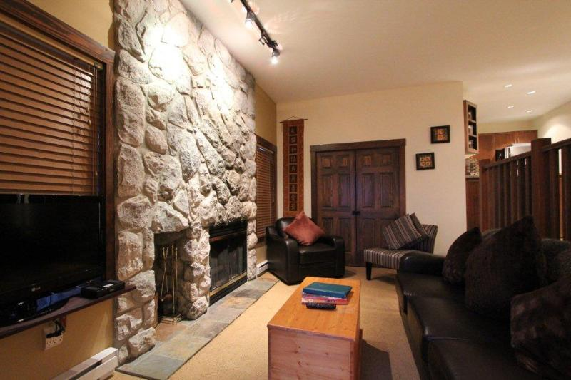 Living room with stone fireplace - Affordable Luxury! Cute Ski in/Out 2 Bed Townhouse - Whistler - rentals