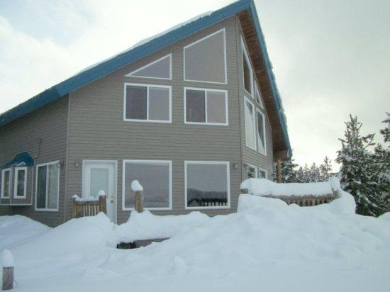 Serenity Lodge, 5 BR, 3 Bath, on Edge of Meadow  Easy snowmobile access! - Image 1 - Island Park - rentals
