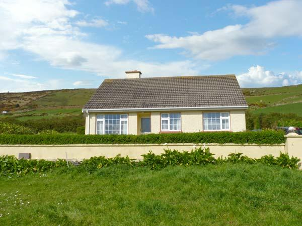 ST FINANS BAY COTTAGE, a single storey, detached cottage, with open fire, and lawned gardens, in Ballinskelligs, Ref 15299 - Image 1 - Ballinskelligs - rentals