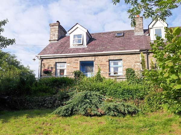 BRYNABER, cottage with open fire, original quarry tile floor, large deck with furniture in Aberbanc, Ref 15932 - Image 1 - Newcastle Emlyn - rentals
