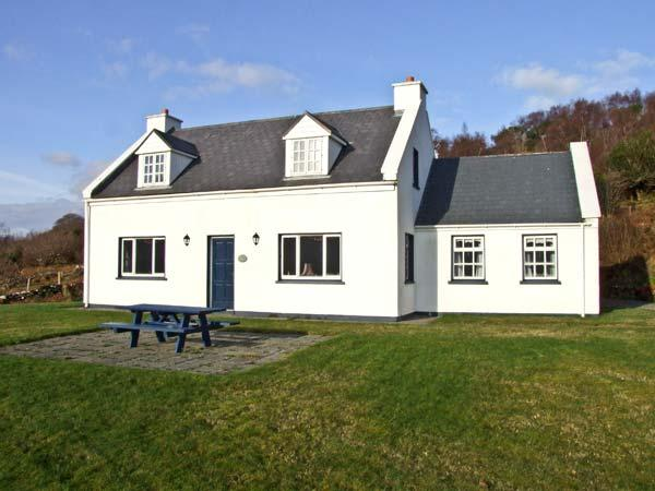 DERRIANA LODGE, detached holiday home with open fires, and views over Lough Derriana, near Waterville in County Kerry, Ref 8255 - Image 1 - Waterville - rentals