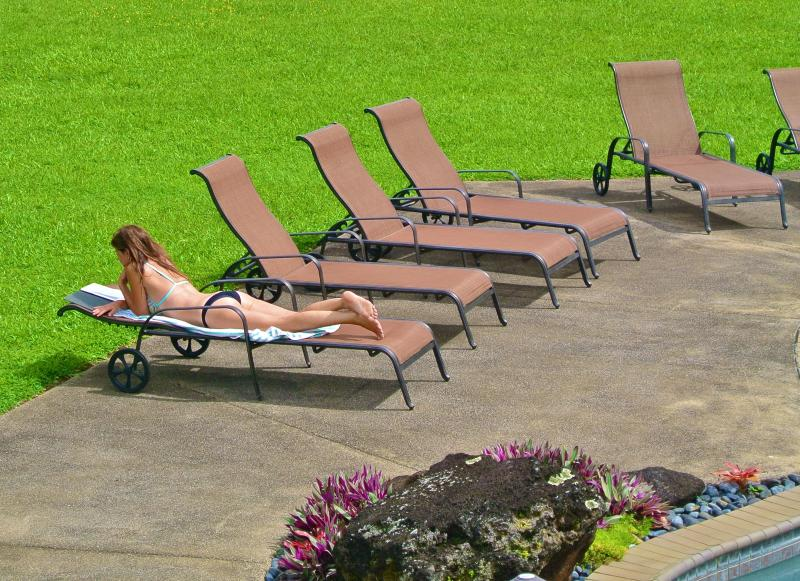 Owner Kimmy reading By The Pool - Ke Aloha Estate - #1 Resort Home With Pool & Gym - Princeville - rentals