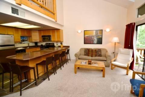 Spacious and comfortable country-style home & family room with fireplace, floor to ceiling windows, private balcony & 42