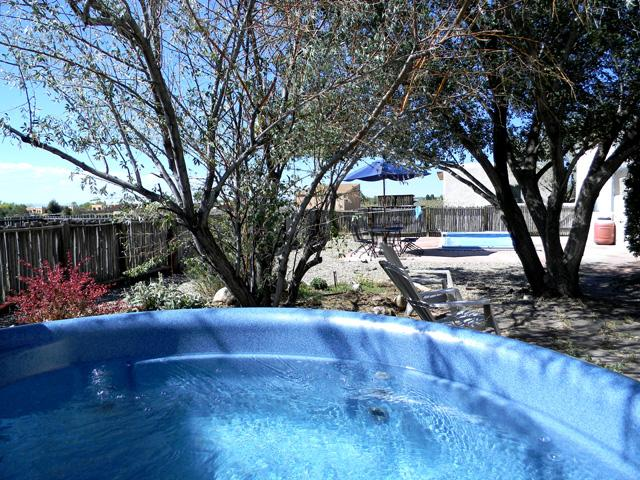 Private hot tub in enclosed yard with mountain views, Endless wave pool in background - Scrabble House Compound - Taos - rentals
