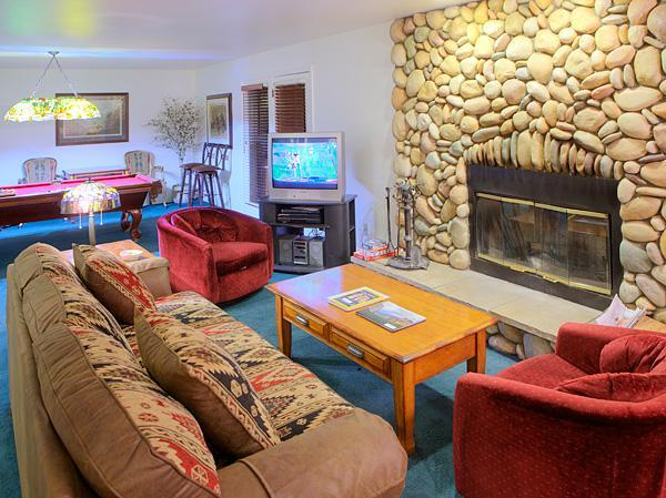 View of the full living room w/ fireplace, queen size sofa bed, fireplace and pool table. - Mountain Luxury With All the Comforts of Home! - Yosemite National Park - rentals