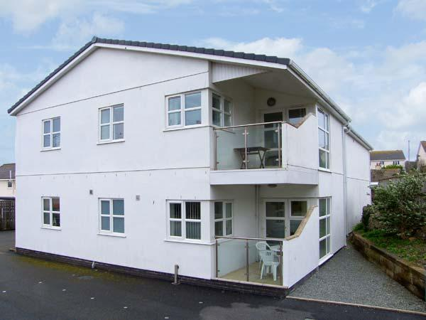 TIDES, minute from sandy beach, ground floor accommodation, enclosed patio, village location, Ref 14479 - Image 1 - Benllech - rentals