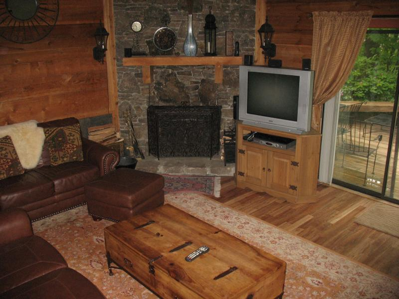 Living Room, with stone wall fireplace, wood floor, leather sofas - Fabulous Mountain Home in Hidden Valley! - Hidden Valley - rentals