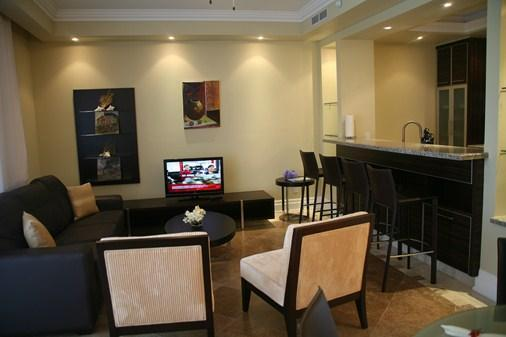 Living room with queen pull-out sofa bed and two large accent chairs - Stunning, modern 1 BDRM condo at The Atrium Resort - Leeward - rentals