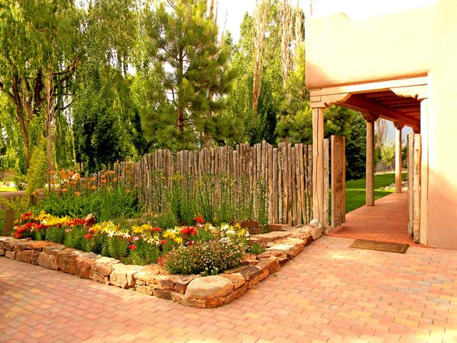 The open gate French Door entry is only the beginning of the lush garden landscaping throught Garden Oasis - Garden Oasis - Taos - rentals