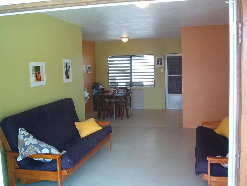 Living room with 2 queen sized sofa couches. The up has been repainted in bright tropical colors. - Casa Mango. Your home away from home in paradise. - Culebra - rentals