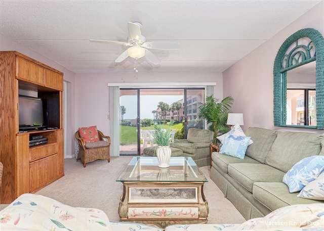 Our 1st floor living room opens to the patio with ocean view - Sea Place 13137, Ground Floor, Pool, Tennis, & Beach - Saint Augustine Beach - rentals