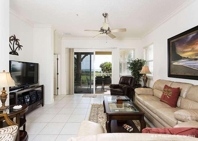 Tile floors and silent ceiling fans keep the living room cool! - 625 Cinnamon Beach - Palm Coast - rentals