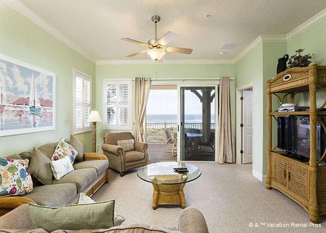 The living room has a beachy feel to it! - 831 Cinnamon Beach, 3rd Floor Ocean Front, HDTV, Sweeping Views - Palm Coast - rentals