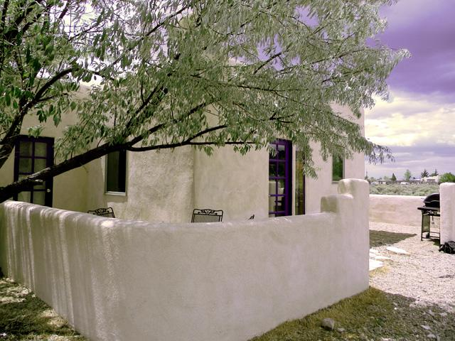 Viewing past adobe privacy wall to enclosed front patio - Scrabble House Casita Cabin - Taos - rentals