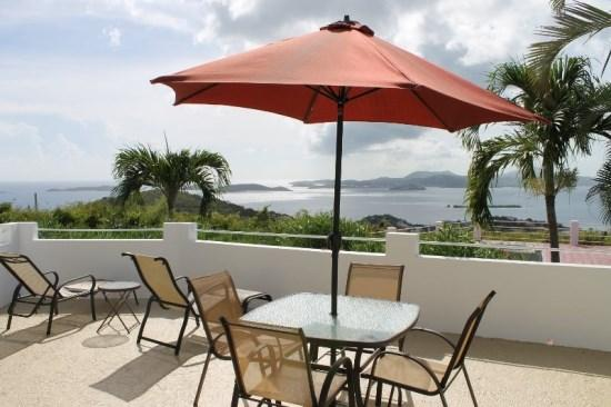 Private courtyard offers ocean views, BBQ grill, and seating/lounging areas - Sunset Ridge Villa C - Saint John - rentals