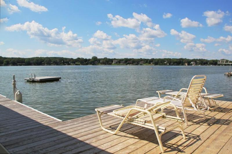 Swim right off the sun pier to the swim raft.  Sandy area for kids to play. - Luxury 4 bedroom home on Whitewater Lake - Whitewater - rentals