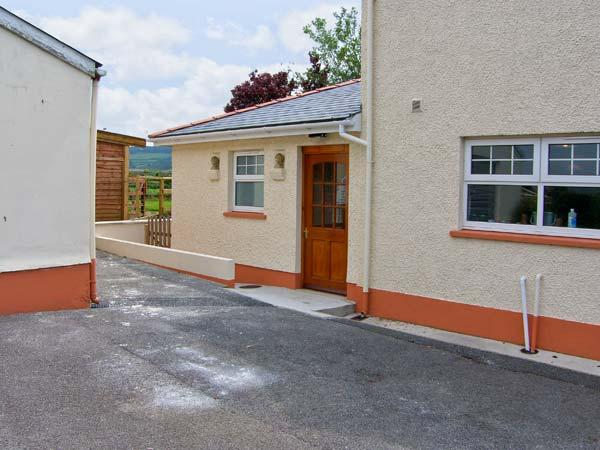 CWTCH COWIN, is a cottage close to picturesque walks, pet-friendly, with a garden, in Carmarthen, Ref 18113 - Image 1 - Carmarthen - rentals