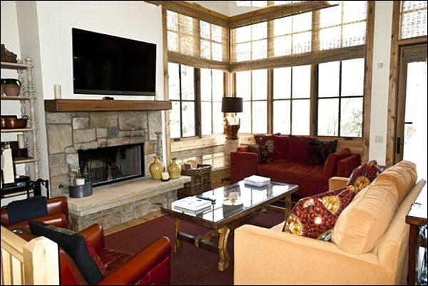 Spacious and Sunny Living Room Features a Fireplace and Flat-Screen TV - Breathtaking Luxury Home - Beautiful Village Views (1149) - Ketchum - rentals