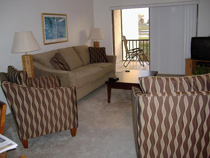 View from dining area into living room including porch - 2 bedroom condo Indian River Plantation Florida - Stuart - rentals