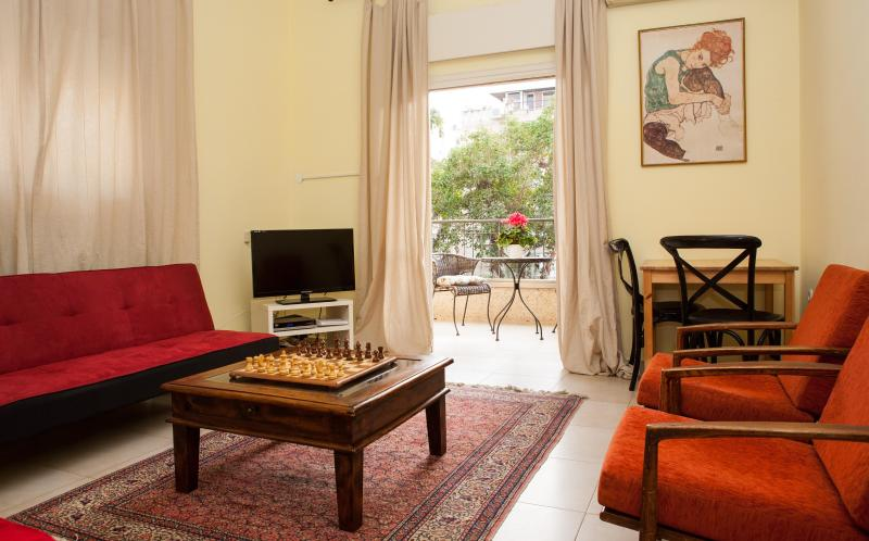 Living room and Balcony - Ben Gurion Boulevard Just minutes from the Beach! - Tel Aviv - rentals