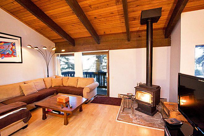 Mammoth Point #123 Living area with a wood burning fireplace - Mammoth Point 123 - Mammoth View Rental - Mammoth Lakes - rentals