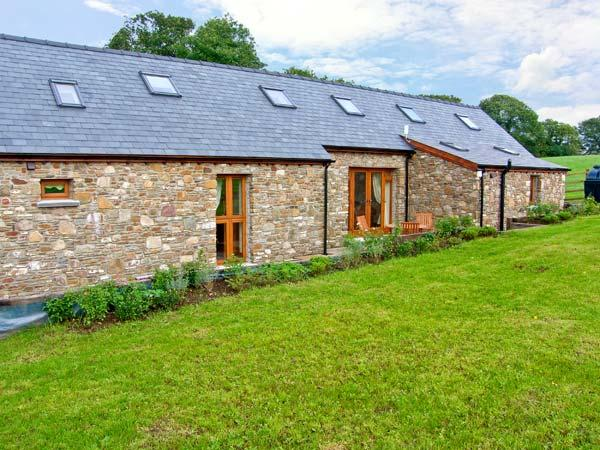 YSGUBOR HIR, stone cottage, surrounded by open fields, lawned garden, off road parking, in Llanedi, Ref 16482 - Image 1 - Llanedi - rentals