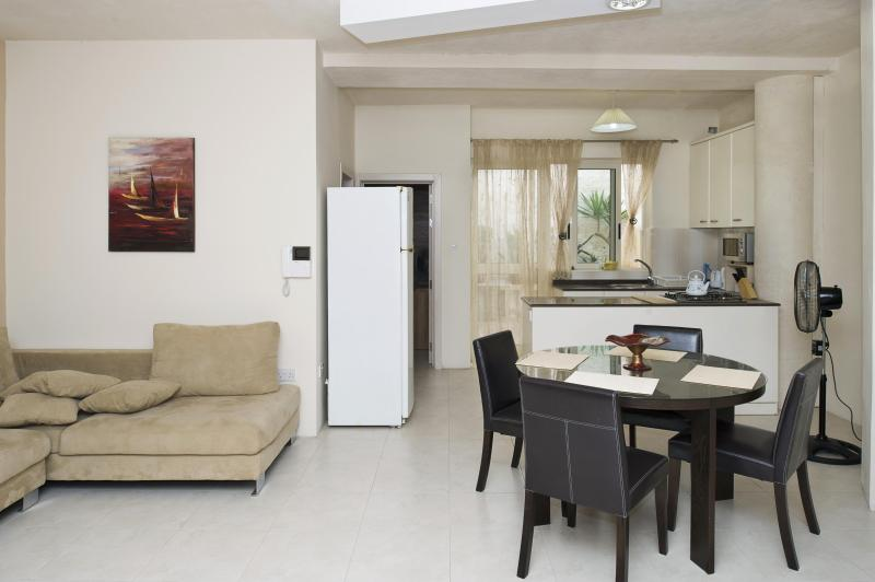 Living / dining with kitchen in the background - Village Core Guest House - Daisy - Ground Floor - Island of Malta - rentals