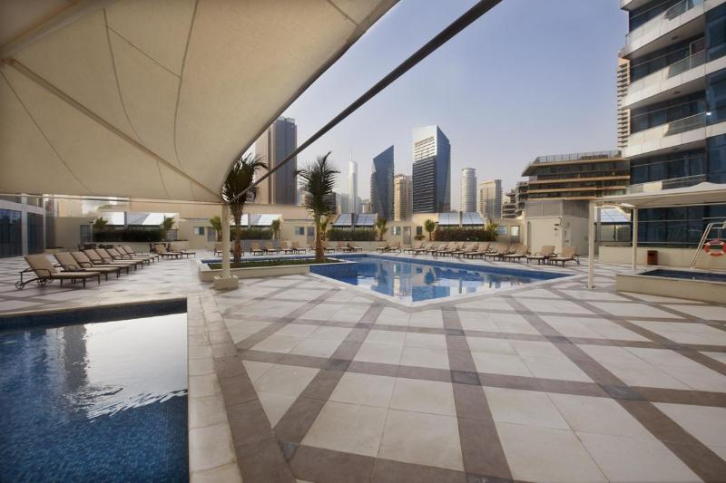 Swimming Pool with plenty of loungers - Stylish 4 Bed Apartment on Dubai Marina & JBR Walk - Dubai Marina - rentals