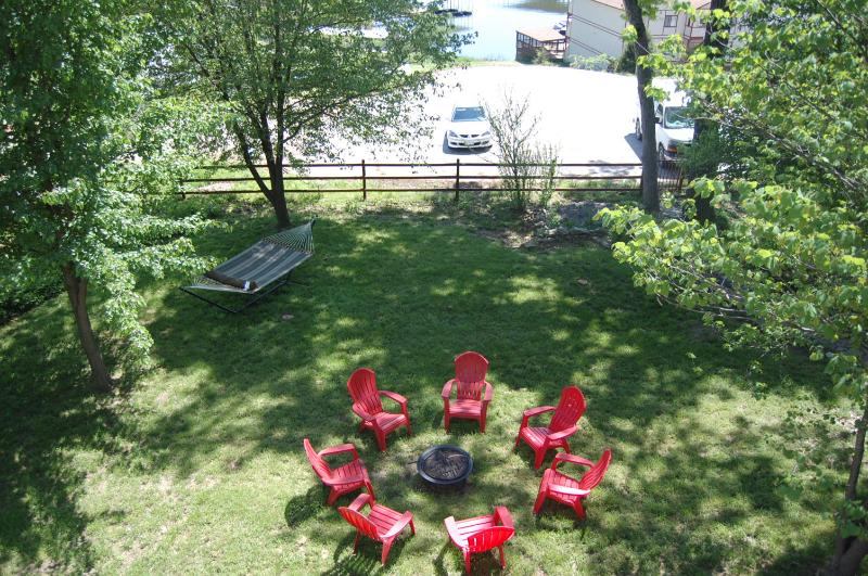 Large backyard, firepit circle and view of lake - Lake Breeze- Entertainment home for the Holiday - Lake Ozark - rentals