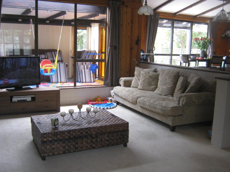 Lounge and through window is sunroom with dining room to the right - 3 bedroom Family Home in Taupo -Close to lake/town - Taupo - rentals