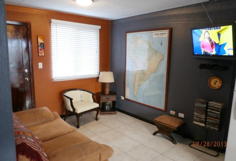 Living area with sofa, chair, flat-screen TV, DVR, stereo, and massive map of South America! - You can't be closer to El Centro w/o being in it!! - Cuenca - rentals