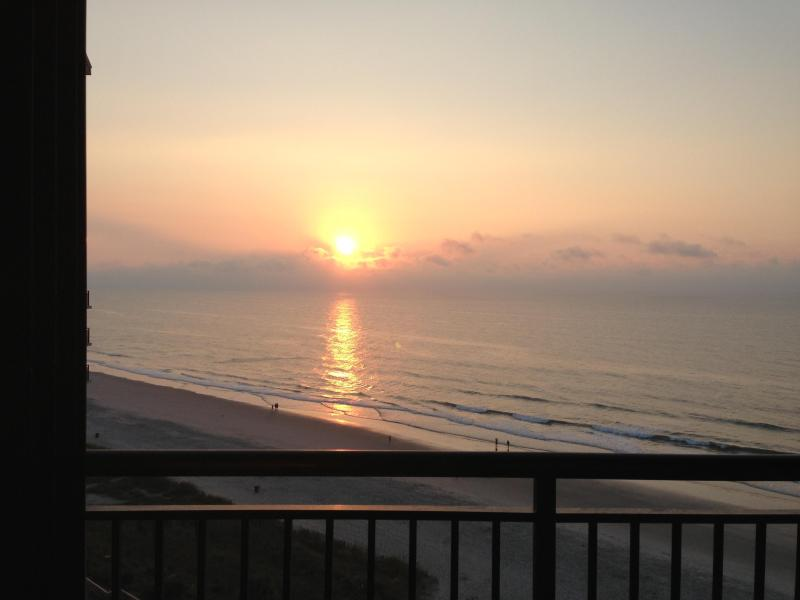 Drink your morning coffee and watch the sunrise from the balcony on the 10th floor. iphone photo! - Family-Friendly Oceanfront Condo in N Myrtle Beach - North Myrtle Beach - rentals