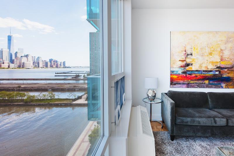 Queen size sofa bed in the living room - Sky City at Newport Blue - 2 bedroom- Private balcony- Manhattan views !! - Jersey City - rentals