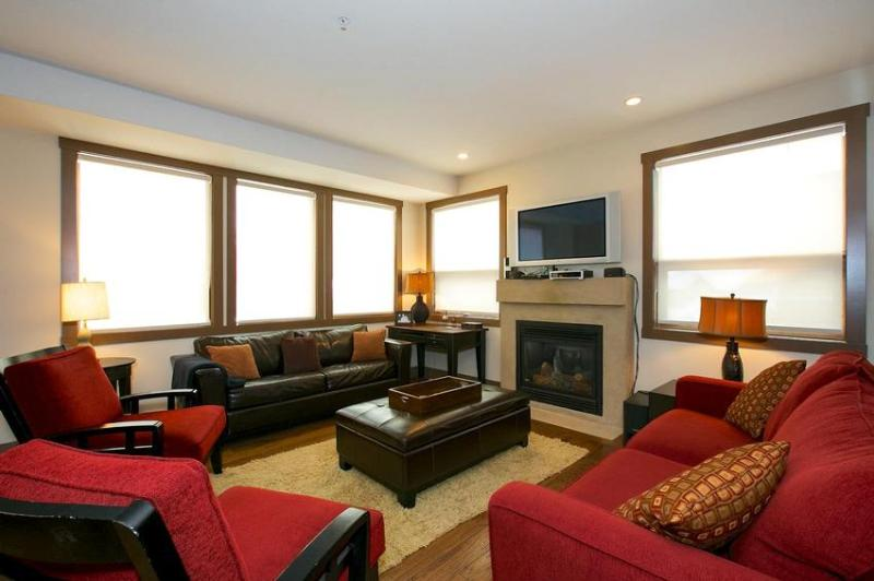 Relax in front of the fire after a day on the slopes. - 101 The Timbers - Big White - rentals