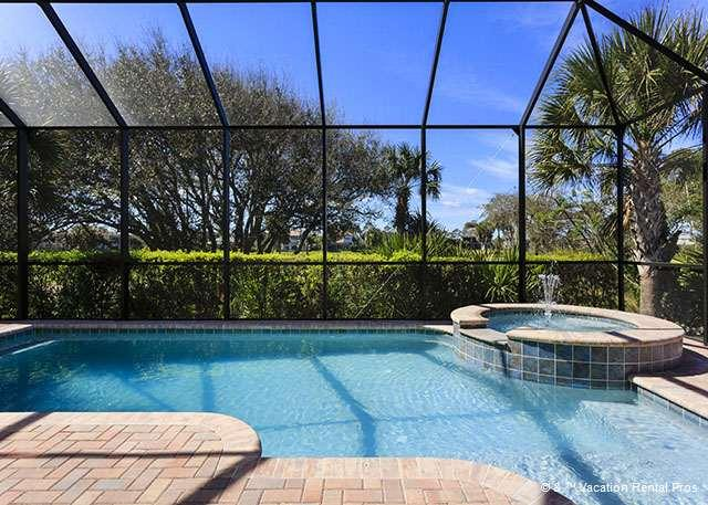 Our atrium-style lanai encloses the pool, spa, and patio. - Morning Glory, Cinnamon Beach, 4 bedrooms, HDTV, Elevator, Pool - Palm Coast - rentals