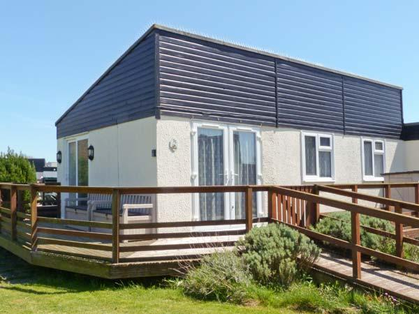 7c MEDMERRY PARK HOLIDAY VILLAGE, close beach, swimming pool, play area, Earnley Ref 19524 - Image 1 - Earnley - rentals