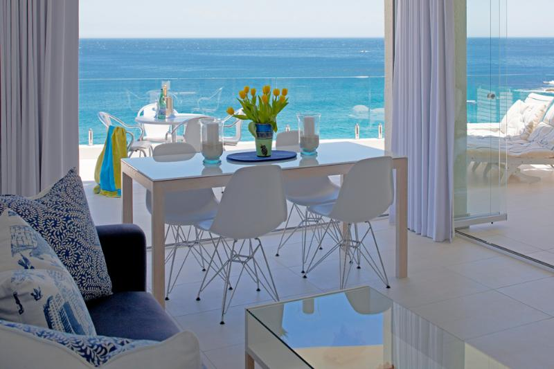 diningroom leading onto patio - Cape Town: Clifton. Just renovated.1st Beach SEAVIEW APARTMENT. Best position in Clifton. On the beach!!! - Clifton - rentals