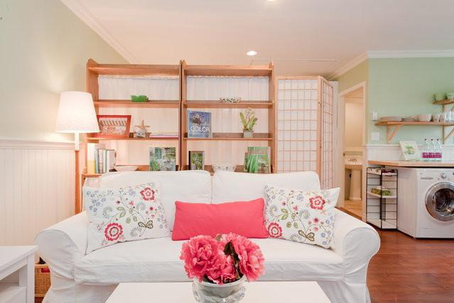 Cozy, warm living room with sofa bed - Garden Cottage Coach House - Awarded Certificate of Excellence 2014 by TripAdvisor! - Vancouver - rentals